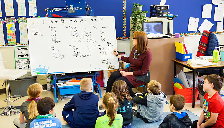 St.-Ambrose988-teacher-math-lesson